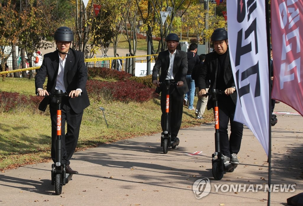 This Nov. 1, 2019, file photo shows participants test riding in an event to promote an electric kickboard sharing service in Hwaseong, 80 kilometers south of Seoul. (Yonhap)