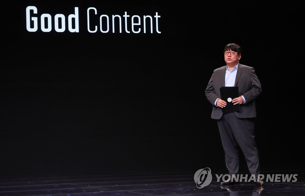 This file photo shows Big Hit Entertainment co-CEO Bang Si-hyuk, who helped launch the career of global K-pop sensation BTS, giving a lecture at the 2019 Culture Innovation Summit at BEXCO in Busan, 450 kilometers southeast of Seoul, on Nov. 25, 2019. (Yonhap)