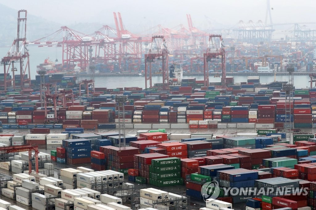The photo, taken Dec. 1, 2019, shows stacks of export-import containers at South Korea's largest port in Busan, located some 450 kilometers south of Seoul. (Yonhap)
