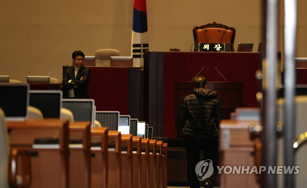 Some lawmakers with the main opposition Liberty Korea Party continue a protest sit-in at the National Assembly in Seoul on Dec. 11, 2019, after the passage of next year's budget bill the other night. (Yonhap)