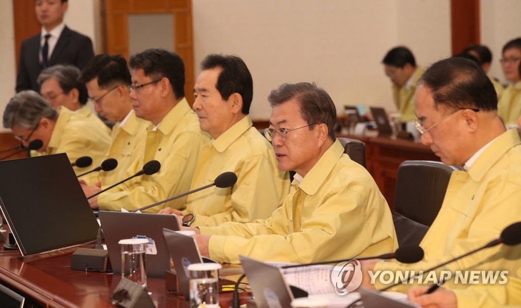 President Moon Jae-in (2nd from R) speaks at a Cabinet meeting held at Cheong Wa Dae in Seoul on Feb. 4, 2020. (Yonhap)