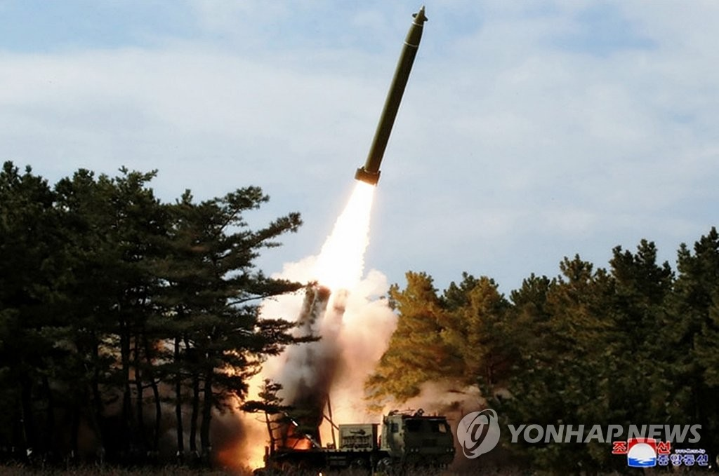 A projectile is launched during a long-range artillery drill by the North Korean army's long-range artillery sub-units on March 2, 2020, in this photo released by the North's official Korean Central News Agency the next day. North Korean leader Kim Jong-un inspected the drill. The report came one day after South Korea said the North fired what appeared to be two ballistic missiles. (For Use Only in the Republic of Korea. No Redistribution) (Yonhap)