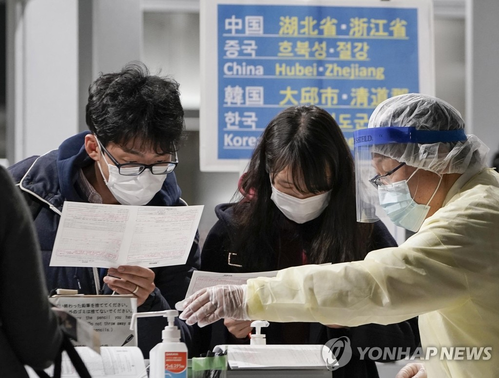 This EPA photo shows passengers undergoing quarantine procedures at Japan's Narita International Airport after arriving aboard a flight from Incheon, South Korea, on March 9, 2020. (Yonhap)