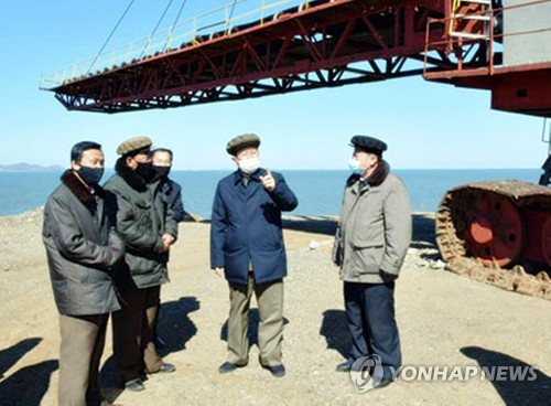 N.K. premier visits economic sites wearing mask