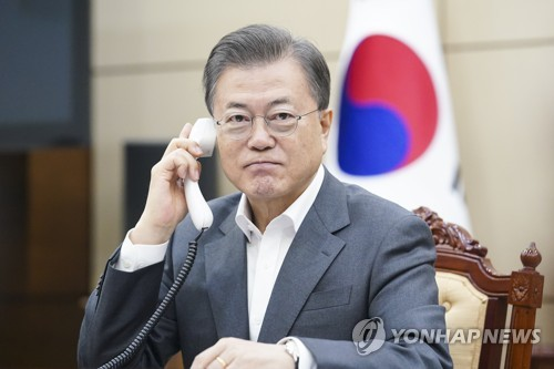 Moon, Gates hold phone talks