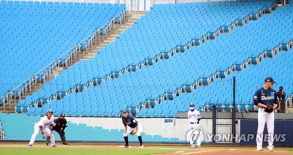 In this file photo from May 5, 2020, the Samsung Lions (in white) and the NC Dinos play their first game of the 2020 Korea Baseball Organization season at an empty Daegu Samsung Lions Park in Daegu, 300 kilometers southeast of Seoul. (Yonhap)