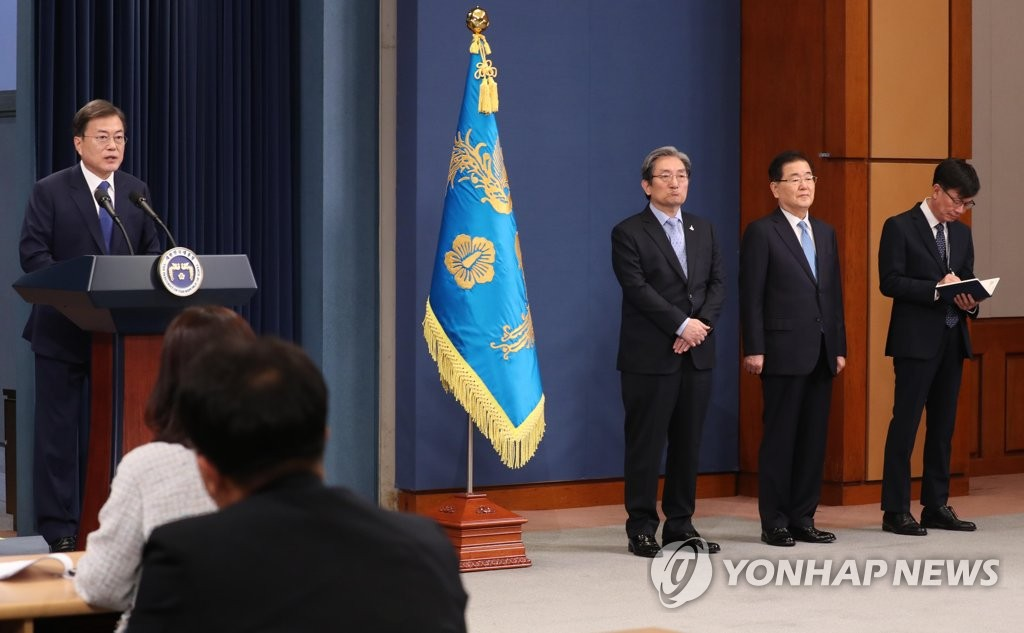 President Moon Jae-in (L) delivers a special address at the Cheong Wa Dae press briefing room on May 10, 2020, the third anniversary of his inauguration. (Yonhap)