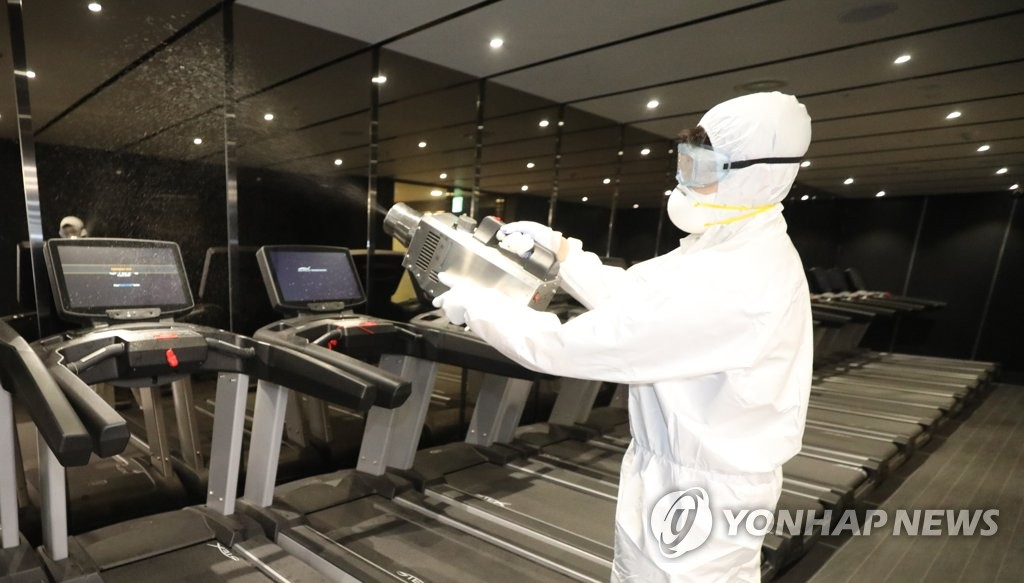 A quarantine worker carries out a disinfection operation at a gym in Seoul's popular multicultural neighborhood of Itaewon on May 11, 2020. (Yonhap)