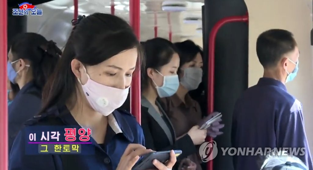 North Korean people wearing masks ride a train to work in Pyongyang on May 13, 2020, in this image taken from a video aired by North Korea's propaganda website DPRK Today. The airing of the video appears to show that North Korea, which claims it has no coronavirus cases, has successfully handled the global pandemic. (PHOTO NOT FOR SALE) (Yonhap)