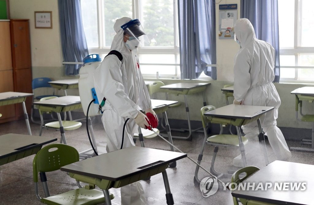 Disinfection under way at Busan high school
