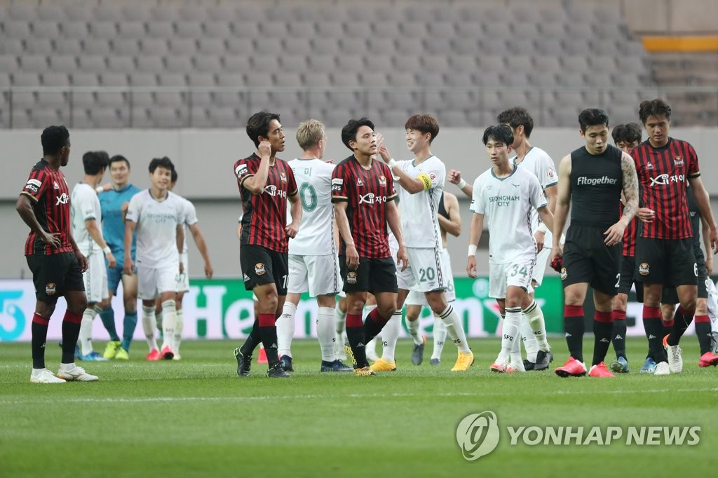In this file photo from May 31, 2020, FC Seoul players (in red shirts) react to their 1-0 loss to Seongnam FC in their K League 1 match at Seoul World Cup Stadium in Seoul. (Yonhap)
