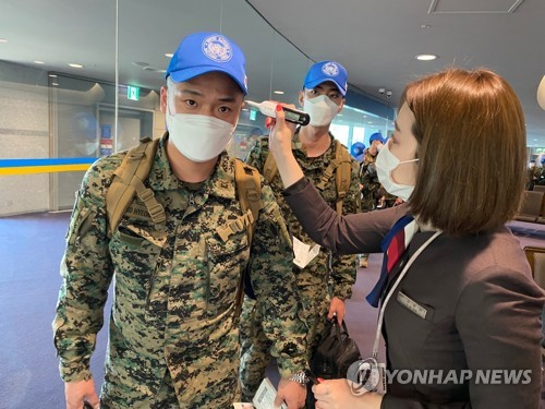 Peacekeeping troops checked for fever before boarding plane