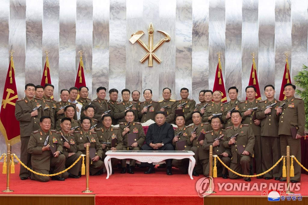 North Korean leader Kim Jong-un (C, front) poses for a group photo with the North Korean army's leading commanding officers during a ceremony at the headquarters of the Party Central Committee in Pyongyang on July 26, 2020, to confer Mount Paektu commemorative pistols to them, in this photo released by the Korean Central News Agency. The ceremony was held as part of events to mark the 67th anniversary of the 1950-53 Korean War armistice to fall on the next day. North Korea refers to the three-year conflict as the great Fatherland Liberation War. (For Use Only in the Republic of Korea. No Redistribution) (Yonhap)