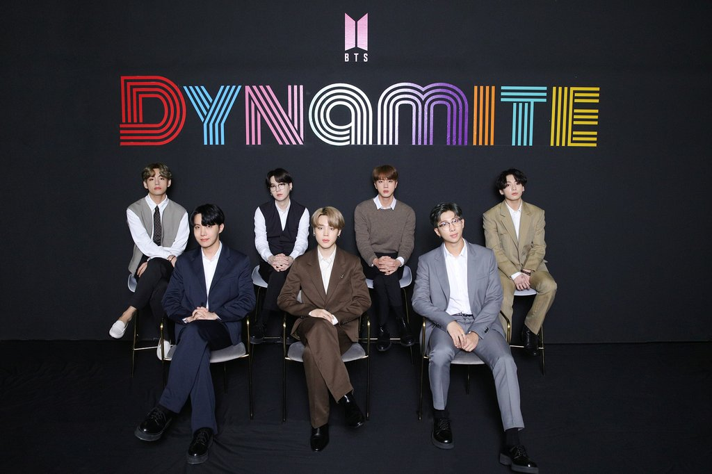 "This photo, provided by Big Hit Entertainment, shows the members of BTS posing for photos during an online media day event in Seoul on Sept. 2, 2020. The band's ""Dynamite"" topped Billboard's main Hot 100 singles chart in the United States on Aug. 31. (PHOTO NOT FOR SALE) (Yonhap)"
