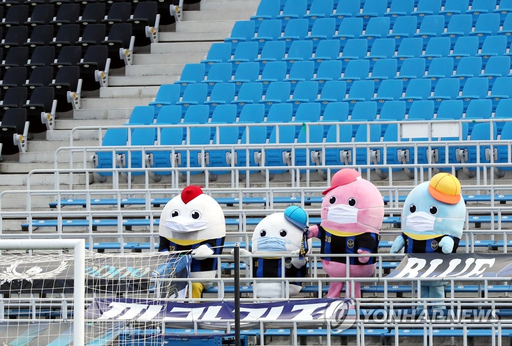 In this file photo from Sept. 20, 2020, mascots for Incheon United watch a K League 1 match between Incheon and Ulsan Hyundai FC at Incheon Football Stadium in Incheon, 40 kilometers west of Seoul. (Yonhap)