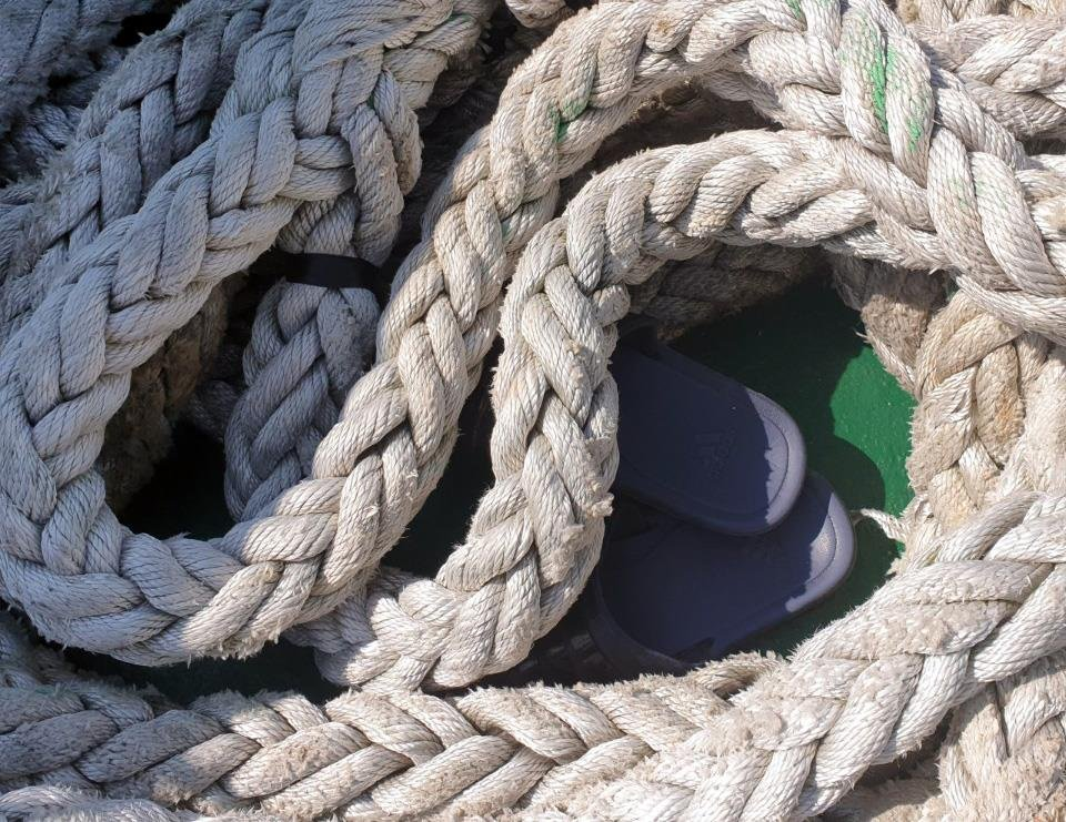 This photo, released by the elder brother of a South Korean official on Sept. 24, 2020, shows a pair of slippers under ropes that the oceans and fisheries ministry says one of its employees is believed to have taken off while onboard a fishery guidance ship. The employee, who went missing on Sept. 21 while carrying out duties in waters off the western border island of Yeonpyeong in the Yellow Sea, was killed by North Korean soldiers the following day, according to South Korean officials. (PHOTO NOT FOR SALE) (Yonhap)