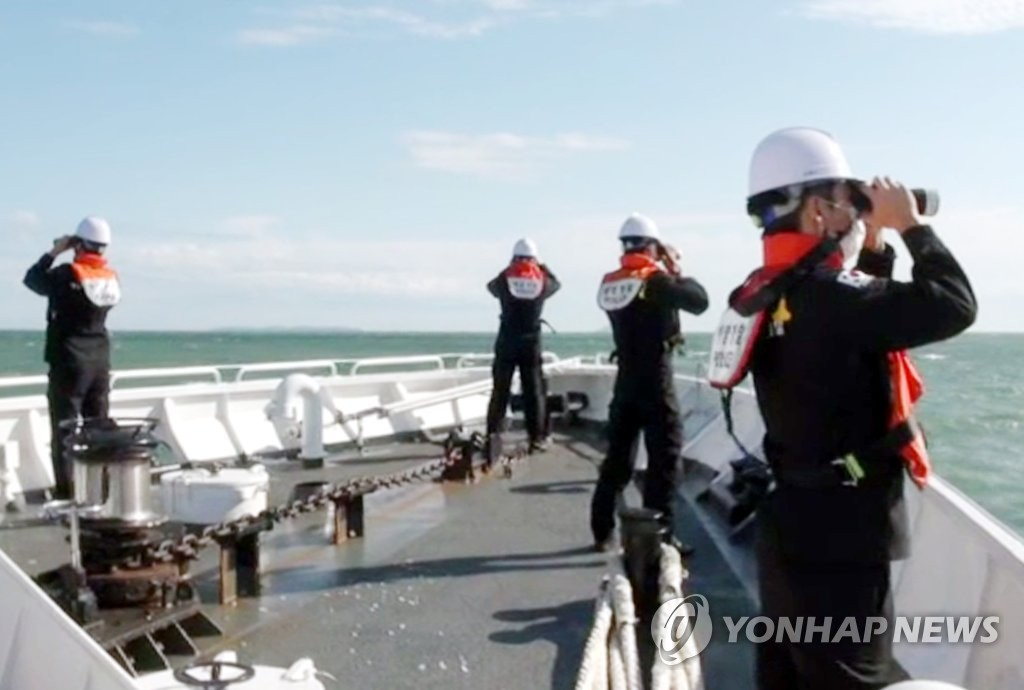 South Korea's coast guard officials search for the belongings of a fisheries official, killed by North Korea's military, near the western sea border on Sept. 27, 2020, in this photo provided by the Incheon station of the Korea Coast Guard. (PHOTO NOT FOR SALE) (Yonhap)
