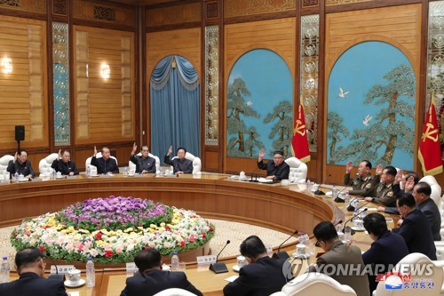N.K. leader presides over politburo meeting