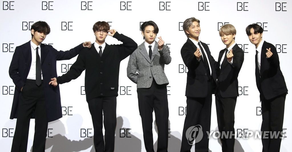 Members of K-pop group BTS pose for a photo shoot ahead of a press conference held at the Dongdaemun Design Plaza in central Seoul on Nov. 20, 2020. (Yonhap)