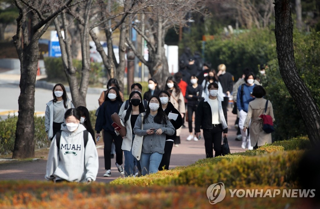 Students wearing masks walk around Chosun University's campus in Gwangju, 330 kilometers southwest of Seoul, on March 8, 2021. (Yonhap)