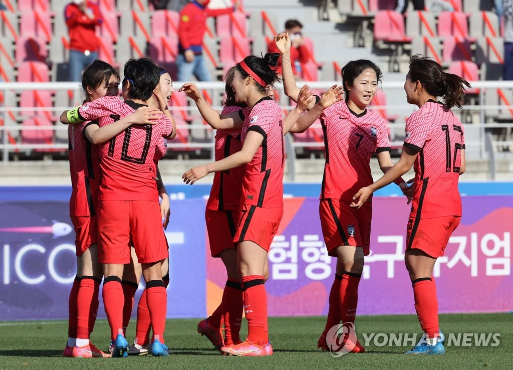 South Korean players celebrate a goal by Kang Chae-rim against China during the teams' Olympic women's football qualifying match at Goyang Stadium in Goyang, Gyeonggi Province, on April 8, 2021. (Yonhap)