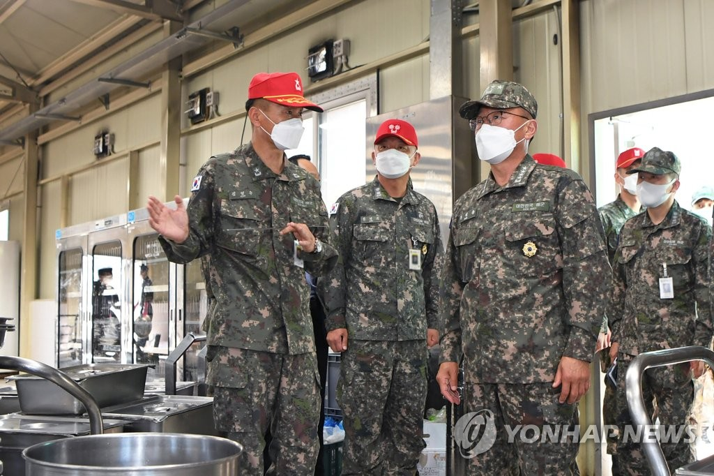 High-ranking officers of the South Korean Navy visit a restaurant for recruits to inspect the Navy's measures against the new coronavirus on May 3, 2021, in this photo provided by the Navy. (PHOTO NOT FOR SALE) (Yonhap)