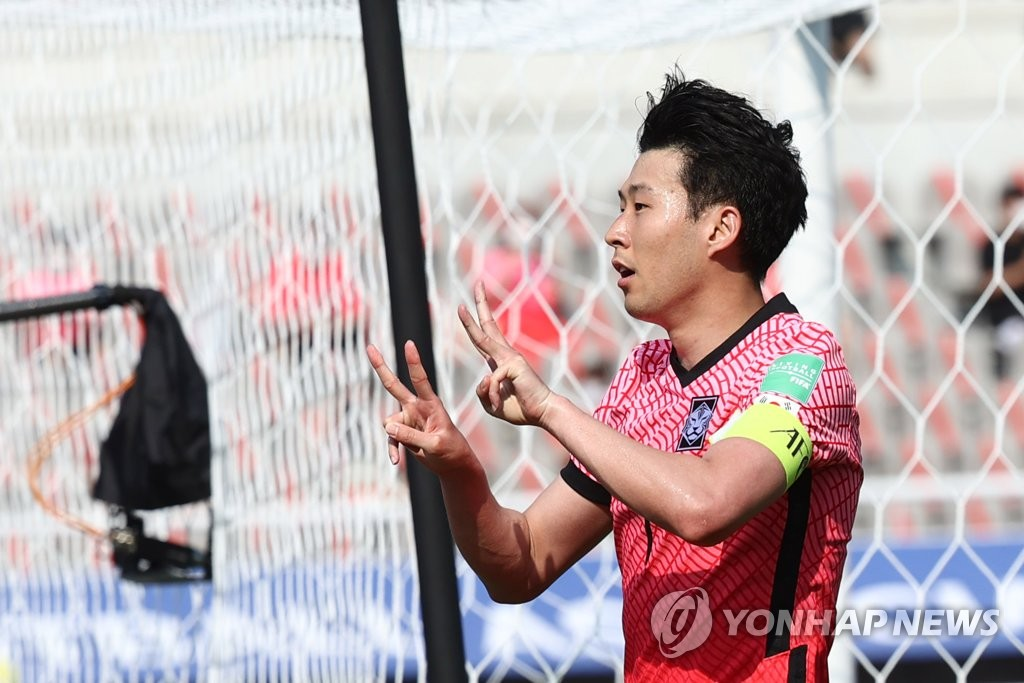 """Son Heung-min of South Korea celebrates his goal against Lebanon during the teams' Group H match in the second round of the Asian qualification for the 2022 FIFA World Cup at Goyang Stadium in Goyang, Gyeonggi Province, on June 13, 2021. Son is holding up his fingers to make it """"23,"""" the number for his former Tottenham Hotspur teammate Christian Eriksen. Playing for Denmark, Eriksen collapsed during a Euro 2020 match against Finland on June 12, 2021. (Yonhap)"""