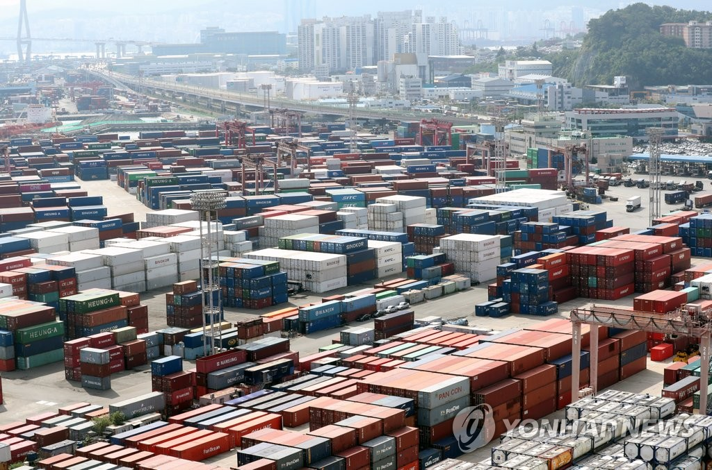 This photo, taken Aug. 2, 2021, shows stacks of containers at a port in South Korea's southeastern city of Busan. (Yonhap)